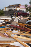 Tornado Storm Damage House Home Destroyed by Wind. Tornado wind and storm wreaks severe damage onto a residential family home. The structure is damaged beyond Stock Image