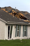 Tornado Storm Damage House Home Destroyed by Wind. Tornado wind and storm wreaks severe damage onto a residential family home. The structure is damaged beyond Stock Images