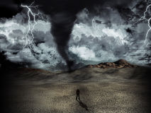 Tornado storm. Silhouette of a man stood in the desert in the middle of a storm with tornado and lightning Royalty Free Stock Photos