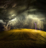 Tornado in stormy landscape Stock Photos