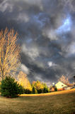 Tornado watch day. Front yard in a residential community graced by storm clouds Stock Images