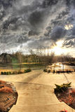 Tornado watch day3. Front yard in a residential community graced by storm couds Stock Images