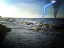Tornado on the water, lightning. Stock Photos