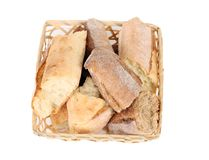 Torned bread in basket. Stock Images