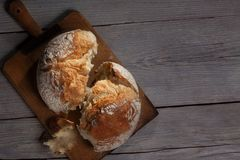 Torned Homemade Bread Loaf On Old Cutting Board With A Free Space On The Right Royalty Free Stock Images