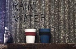 Torneira de água da chuva Imagem de Stock Royalty Free