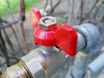 Torneira de água vermelha Foto de Stock Royalty Free