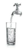 Torneira e água Fotografia de Stock