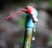 Torneira e água Fotografia de Stock Royalty Free