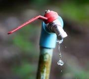 Torneira e água Imagem de Stock