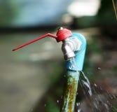 Torneira e água Imagens de Stock Royalty Free