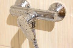 Torneira molhado no banheiro Fotografia de Stock Royalty Free