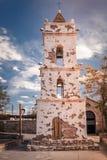Tornet av kyrkan staden Toconao som byggs i århundradet för th 18, tillhör kommunen av San Pedro de Atacama, i royaltyfri bild