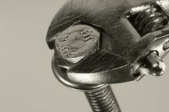 Tornillo y llave Foto de archivo libre de regalías