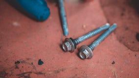 Tornillo y nueces industriales del hex. imagenes de archivo
