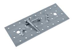 Tornillo y nueces plateados de metal perforados de los muebles Imagen de archivo