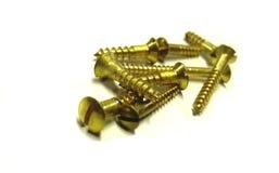 Tornillos de cobre amarillo usados en la construcción fotos de archivo libres de regalías