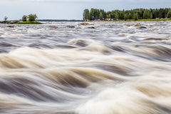 The Tornionjoki river between Finland and Sweden. Stock Image