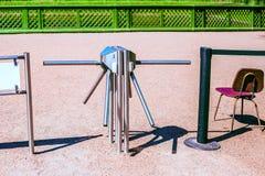 Torniquete e cadeira fora Imagens de Stock
