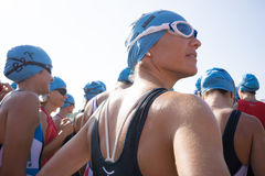 Toro Loco Valencia Triathlon. Valencia, Spain - September 6, 2014: A woman athlete preparing for the swim section of the Women's Toro Loco Valencia Triathlon Royalty Free Stock Photo