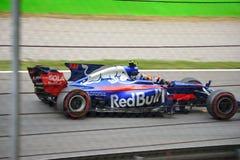 Toro Rosso formel en som är drivande vid Carlos Sainz Jr Royaltyfri Fotografi