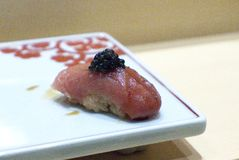 Toro Sushi With Caviar. A rich and decadent sushi consisting of toro, which is fatty Bluefin Tuna, topped with caviar. It is part of the omakase course at royalty free stock photo