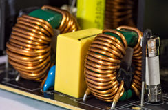 Toroidal pulse transformers. On printed circuit board Royalty Free Stock Photography