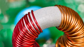 Toroidal transformer detail. Coil winding. Copper wire. Magnetic ferrite core stock images