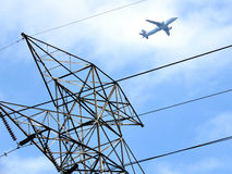 Toronto airplane over transmission tower 2017. Aairplane over transmission tower in Toronto, Canada, June 4, 2017 stock images
