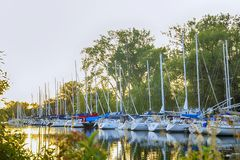 TORONTO - AUGUST 31, 2017: Yachts parking in harbor, Harbor yacht club in Toronto, Ontario, Canada. TORONTO - AUGUST 31, 2017: Yachts parking in harbor, Harbor Stock Images