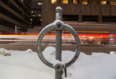 Toronto Bike Lock Covered in Snow at Night Stock Photo