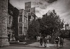 Toronto, Canada - 20 10 2018: Autumn scene with tourists walking in front of historic Hart House building. Hart House is. University of Toronto centre for stock photography