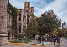 Toronto, Canada - 20 10 2018: Autumn scene with tourists walking in front of historic Hart House building. Hart House is. University of Toronto centre for royalty free stock images