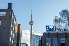Bell Media main office for Toronto and its logo with the Canadian National Tower CN Tower in the background. TORONTO, CANADA - DECEMBER 20, 2016: Bell Media stock images