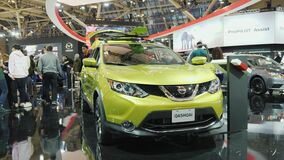 Toronto, Canada, February 20, 2018: People around the new car Nissan Quashai. Exhibition of cars in Toronto. Visitors visiting the new model of the car brand stock video