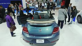 Toronto, Canada, February 20, 2018: Visitors near the new Volkswagen Beetle Convertible at the Great Auto Show in. Visitors near the new Volkswagen Arteon at the stock video footage