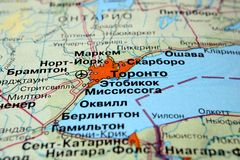 Toronto. Canada on a geographical map with Russian text. Selective focus royalty free stock photos