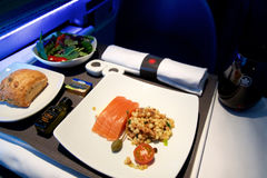 TORONTO, CANADA - JAN 21st, 2017: Air Canada Business Class in-flight meal, Smoked salmon with fregola salad as an Stock Photos