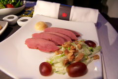 TORONTO, CANADA - JAN 28th, 2017: Air Canada Business Class in-flight meal, dinner with smoked ontario duck breast Stock Photo