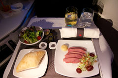 TORONTO, CANADA - JAN 28th, 2017: Air Canada Business Class in-flight meal, dinner with smoked ontario duck breast Royalty Free Stock Photography