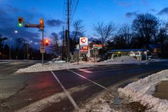 Toronto, CANADA - January 27th, 2019: Frozen Canadian roads after winter blizzard with snow and ice at sunset and end of the day stock image