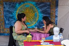 TORONTO, ON, CANADA - JULY 29, 2018: A fortune teller with a client at Kensington market in Toronto. royalty free stock photos
