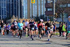 TORONTO, CANADA - May 5th, 2019 - 42nd Annual Toronto Marathon. People running through the city streets. stock image