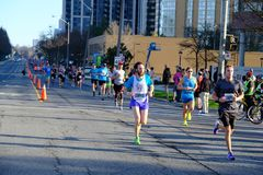 TORONTO, CANADA - May 5th, 2019 - 42nd Annual Toronto Marathon. People running through the city streets. royalty free stock photos