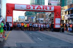 TORONTO, CANADA - May 5th, 2019 - 42nd Annual Toronto Marathon. People running through the city streets. royalty free stock image