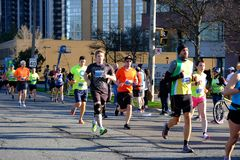 TORONTO, CANADA - May 5th, 2019 - 42nd Annual Toronto Marathon. People running through the city streets. royalty free stock images