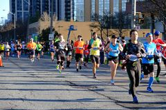 TORONTO, CANADA - May 5th, 2019 - 42nd Annual Toronto Marathon. People running through the city streets.
