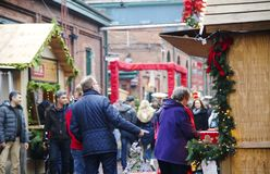 TORONTO, CANADA - NOVEMBER 18, 2017: People visit Christmas market in Distillery Historic District, one of the Toronto`s favourite. Holiday traditions, Canada royalty free stock photography