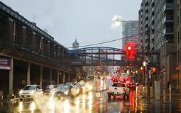 TORONTO, CANADA - NOVEMBER 18, 2017: Street in the rain at evening in the light from traffic light and car lights in Toronto Downt. Own, Canada royalty free stock photos