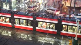 Intersection in Toronto, Canada. Toronto, Canada - Oct 15, 2017: Busy intersection on a rainy night in the city of Toronto. Province of Ontario, Canada stock video